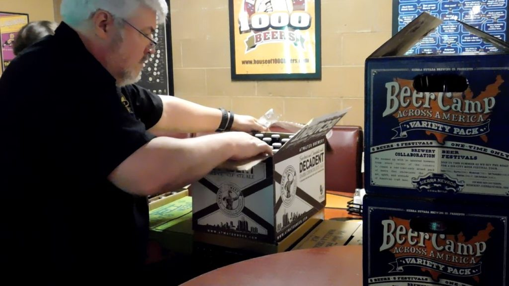House of 1,000 Beers owner Art Barbus unpacks a shipment. Stocking 1,000 beers is hard work.