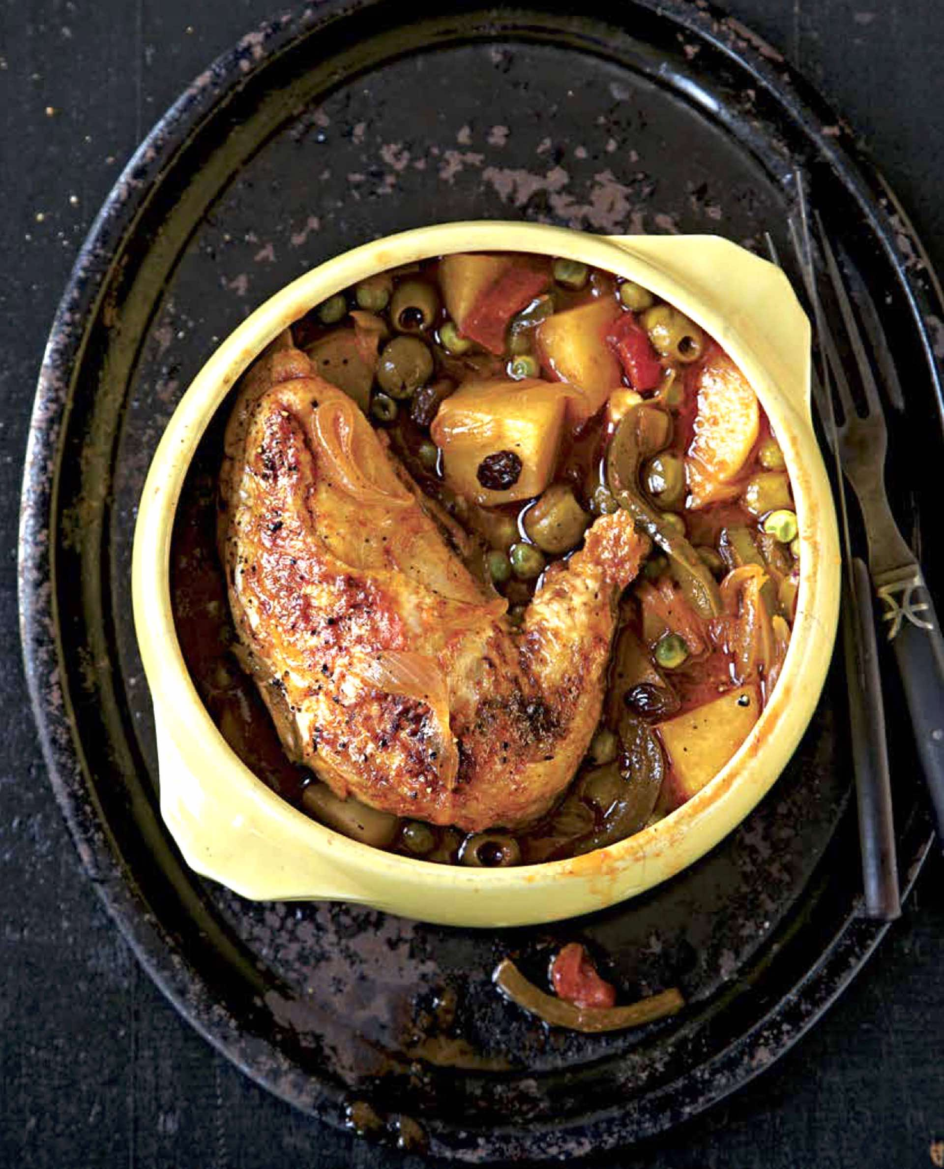 A mix of lime juice, orange juice, dry white wine and raisins add depth of flavor to the savory Cuban-Style Chicken Stew. (Photo by Weldon Owen)