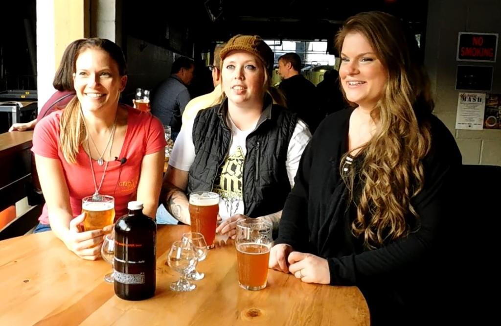 Krystle Eaton, Meg Evans and Devon Murdoch enjoy a beer at Grist House Brewing in Millvale.