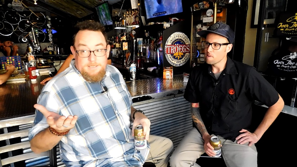 Mike and New Belgium brewer Willy Tarango enjoy two Fat Tires at Over The Bar Bicycle Cafe on Carson Street.
