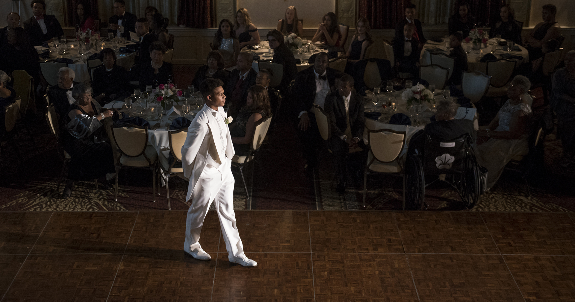 Curtis Aiken Jr. walks across the floor as he is presented at the  Pittsburgh Chapter of Jack and Jill of America Inc.'s 18th Biennial  Presentation Ball in ...