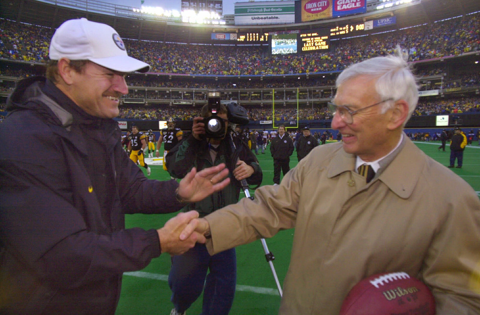 Then-Steelers coach Bill Cowher, left, congratulates Steelers owner Dan Rooney after defeating the Washington Redskins 24-3 in the final game at Three Rivers Stadium on Dec. 16, 2000. (Associated Press)