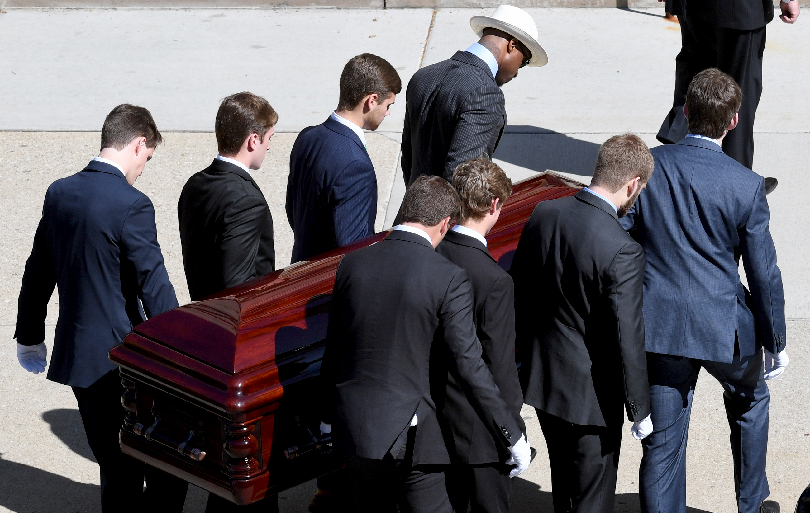 Pallbearers carry the casket of Dan Rooney into Saint Paul Cathedral in Oakland. (Matt Freed/Post-Gazette)