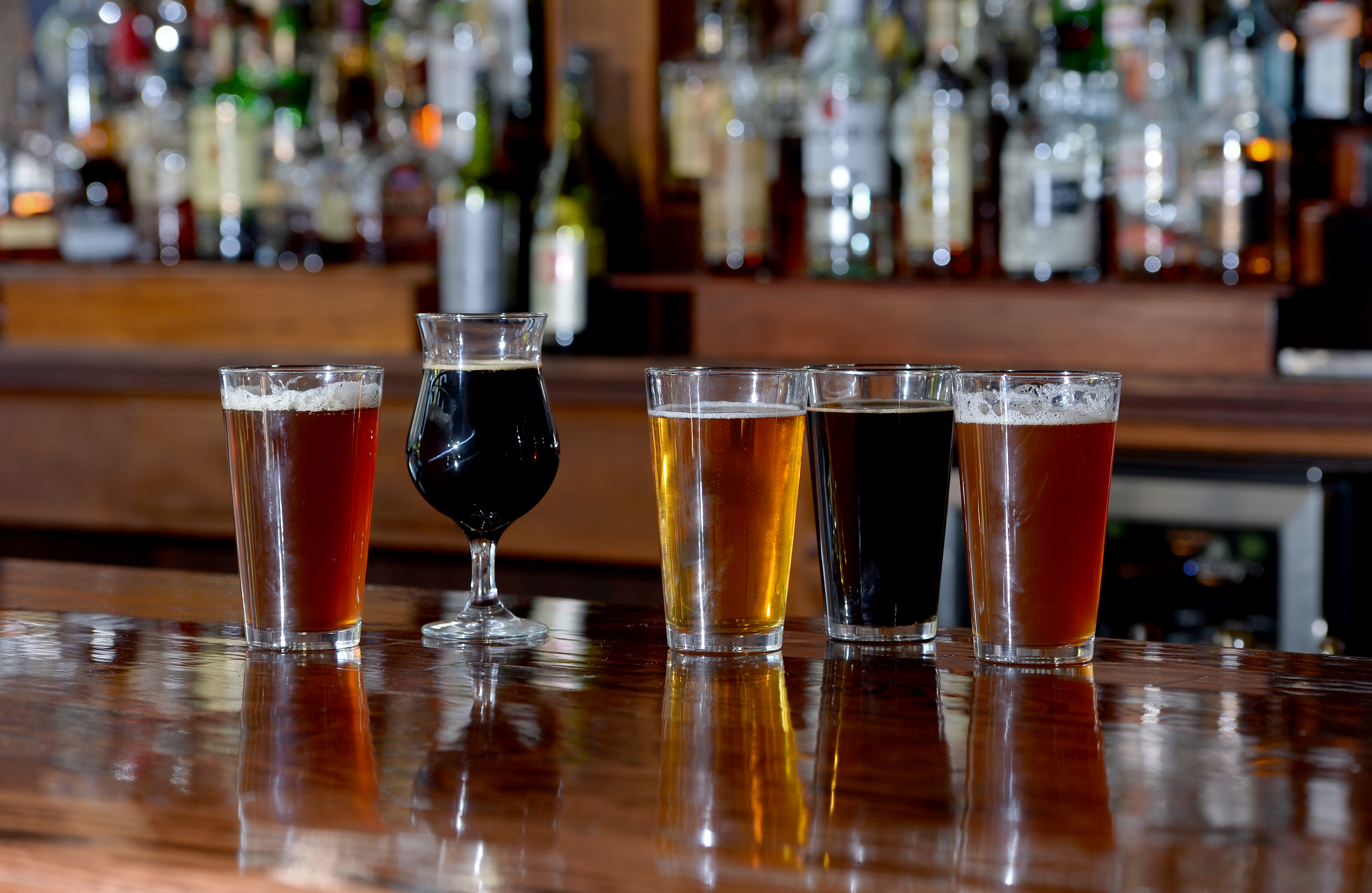Essential beers of Pittsburgh include, from right, Penn Pilsener, Couch Raspberry Duvet, Big Hop IPA, Voodoo Big Black Voodoo Daddy and Sprague H.I.G.H. PA. (Matt Freed/Post-Gazette)